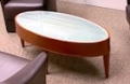 Oval wood glass top coffee table